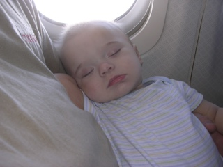 brenden_asleep_on_plane.thumb.jpg
